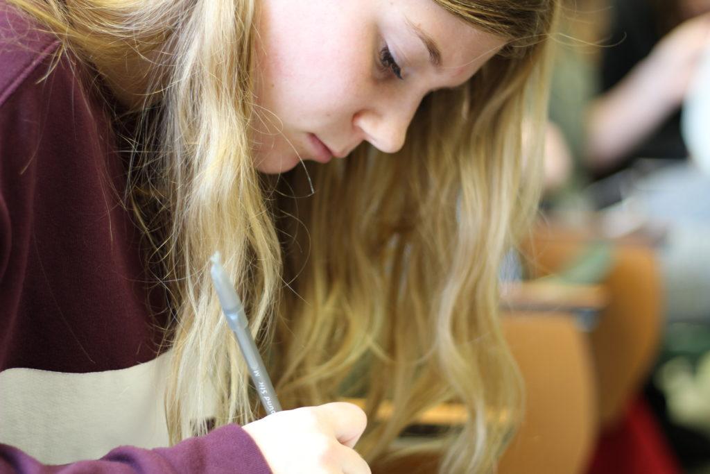 student studying, desk, classroom, writing, Jessica Gavrilovski